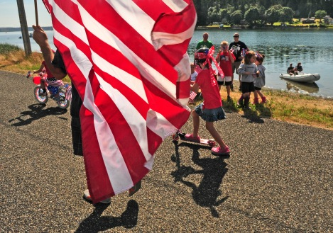 A few hundred people came to Home, Wash., for the neighborhood's annual Fourth of July parade along a bank of Von Geldern Cove.