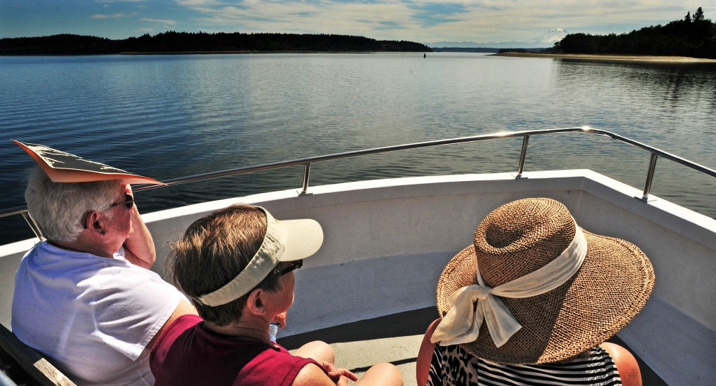 """About 70 people spent an afternoon aboard the Tacoma-based charter boat """"My Girl"""" for a history cruise around McNeil Island ."""