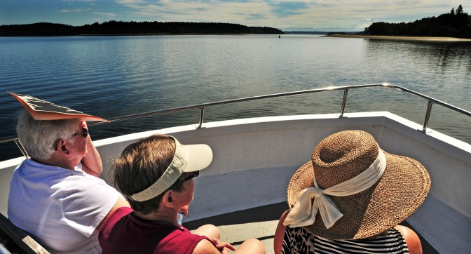 "About 70 people spent an afternoon aboard the Tacoma-based charter boat ""My Girl"" for a history cruise around McNeil Island ."