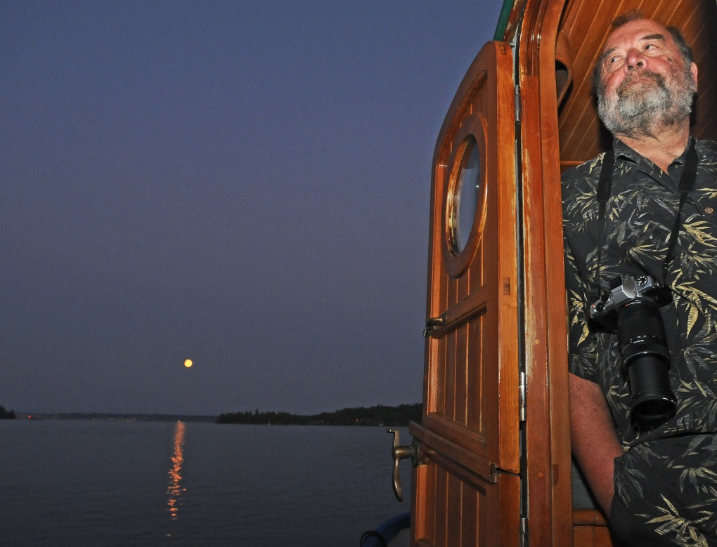 """Richard Hildahl pilots the 37-foot Lord Nelson Victory Tug """"Awesome"""" around Filucy Bay."""