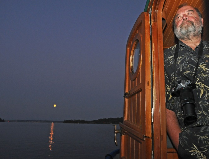 "Richard Hildahl pilots the 37-foot Lord Nelson Victory Tug ""Awesome"" around Filucy Bay."