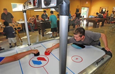 Gage Gehrke, 10, plays a game of table hockey at the Red Barn Youth Center on the Key Peninsula. The youth center has been a community dream for nearly a decade until it opened its doors this week.