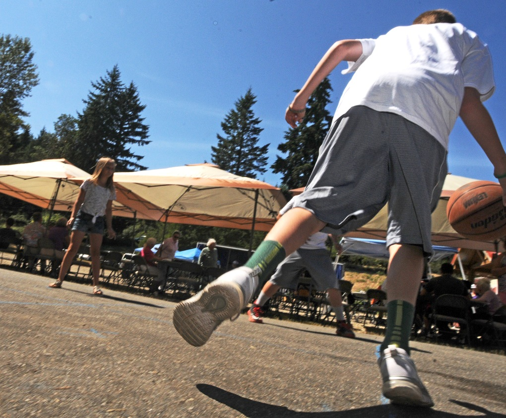 A back room in the 4,650-square foot facility will be converted into a basketball court one day. In the meantime, a hoop on the driveway was just fine for a group of kids at the open house Aug. 10.