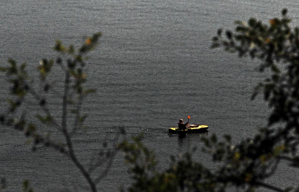 A paddler enjoying a sunny day on Drayton's Passage.