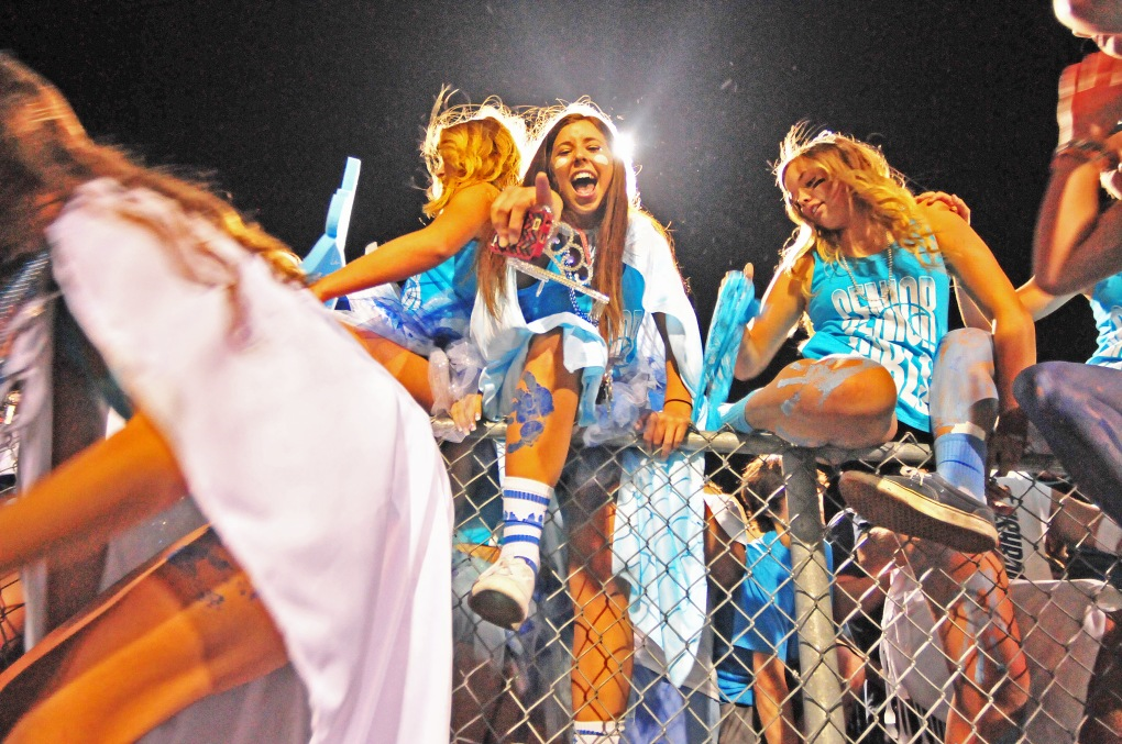 Gig Harbor students rush the field after the Tides defeated their cross-town rivals Seahawks 30-29 in the 36th edition of the Fish Bowl at Roy Anderson Field.
