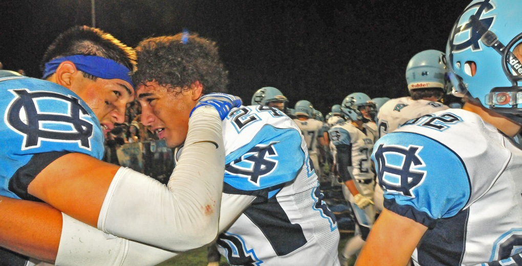 Gig Harbor's Kale Wong, right, and Dre Brazier congratulate each other after what was a hard-fought gridiron battle.