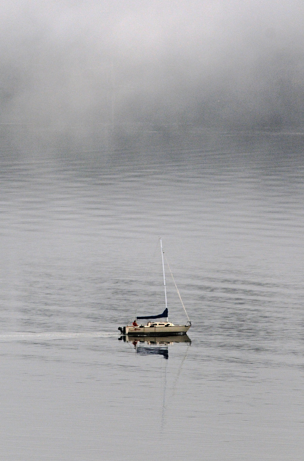 A sailboat powers down Drayton's Passage in the fog early Saturday morning.