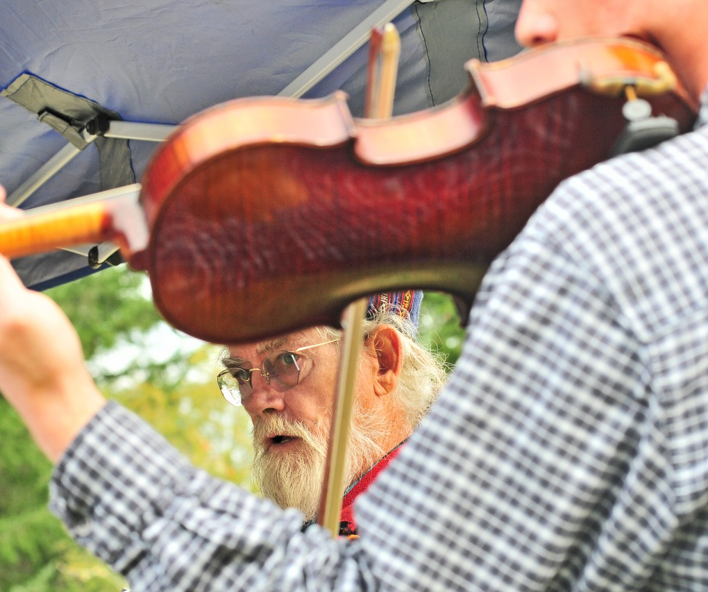 Bill Lloyd performs with local group Bluegrass Minstrels in serenading the crowd at Blue Willow Lavender Farm.