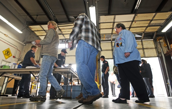 Guest lined up to get their fill of the free breakfast at the fire house in Key Center.