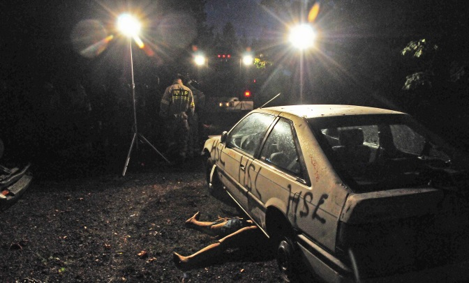 Two cars were setup for the drill in the glare of two portable flood lights.