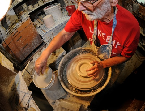 Andersen starts by throwing a lump of clay on the potter's wheel, making sure it stays wet as he works it.