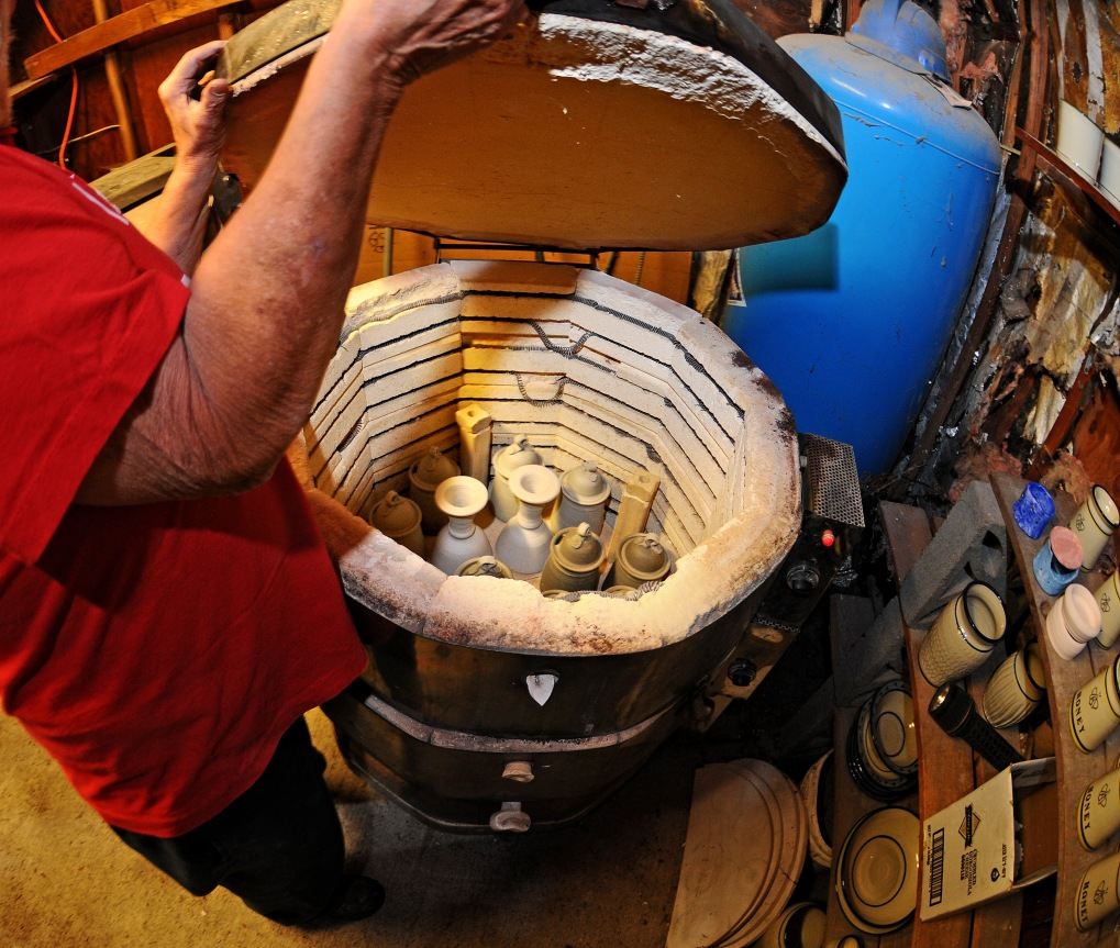 Andersen pulls the lid of one of the kilns inside the pump house on his 17-acre property.