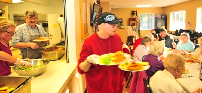 Churches pay for the food while an army of volunteers cook, serve and clean.