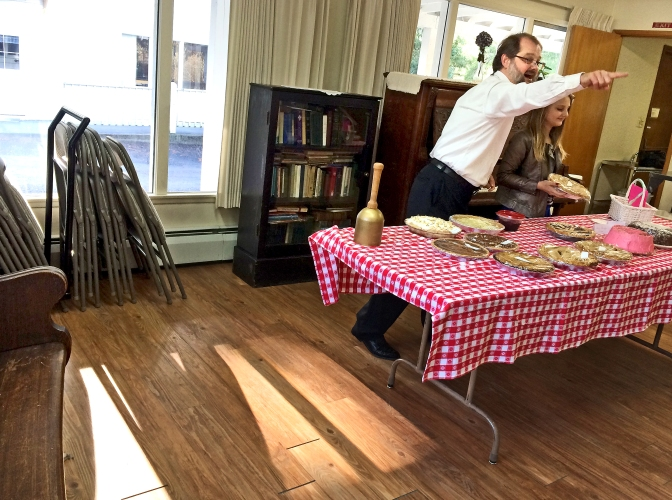 Pastor John Day, of the Longbranch Community Church, auctions off an apple pie at a church fundraiser.