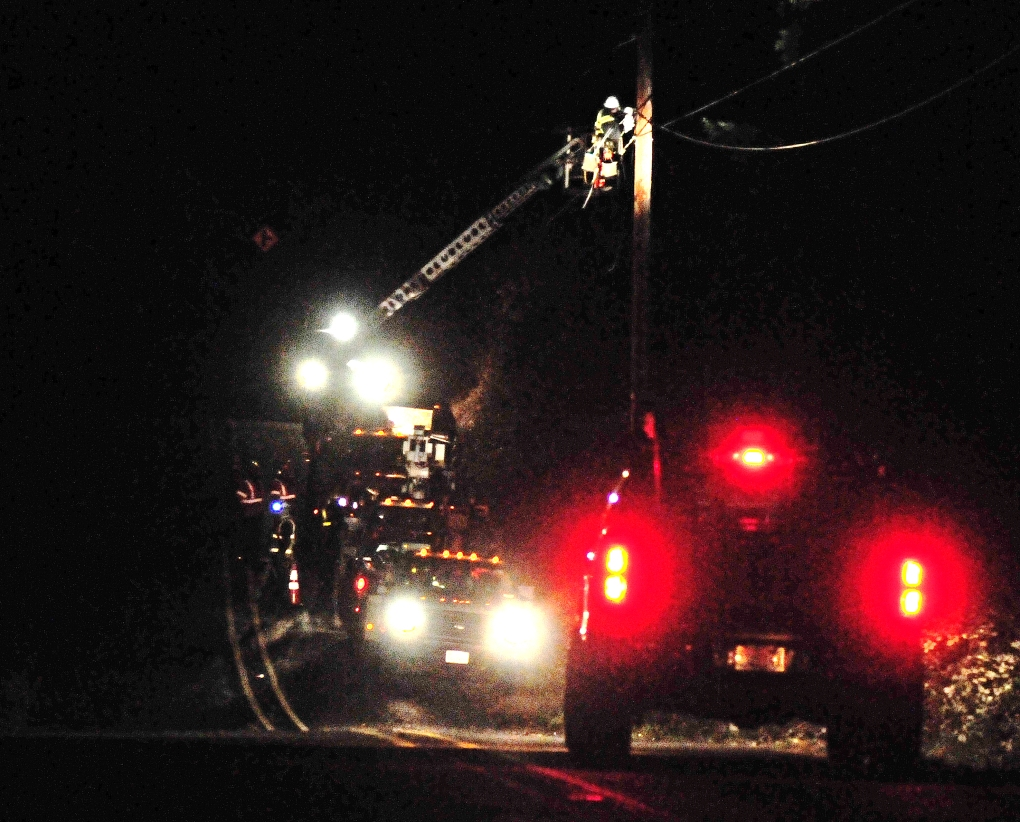 Peninsula Light Company crews working through the night fixing damaged power poles and downed lines. A crew working on a pole just north of 76th Street KPS along the Key Peninsula Highway.