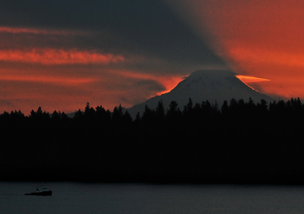 Mount Rainier's shadow seen over Anderson Island from Longbranch.