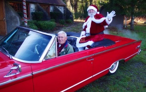 Fred Leenstra delivers Santa at the Longbranch Improvement Club house in a carnival red 1963 Mercury Monterrey. Photo courtesy of Richard Hildahl.