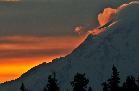The northern slope of Mount Rainier lit up at sunrise Tuesday Feb. 24.