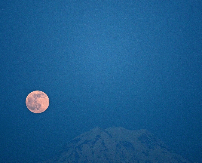 The full moon rising over Mount Rainier and Anderson Island last night.