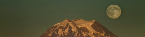 """The moon rises over Mount Rainier seen from Longbranch on the eastern shore of the Key Peninsula Thursday July 30, 2015. For the second time this month, the Moon is about to become full.  There was one full Moon on July 2nd, and now a second is coming tomorrow.  The science.nasa.gov website says that according to modern folklore, whenever there are two full Moons in a calendar month, the second one is """"blue."""""""