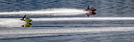 A bit of rain on July 12, 2015, in Longbranch, Washington, cooled things down for personal watercraft enthusiasts as they power past the sandbar on the eastern shore of the Key Peninsula.
