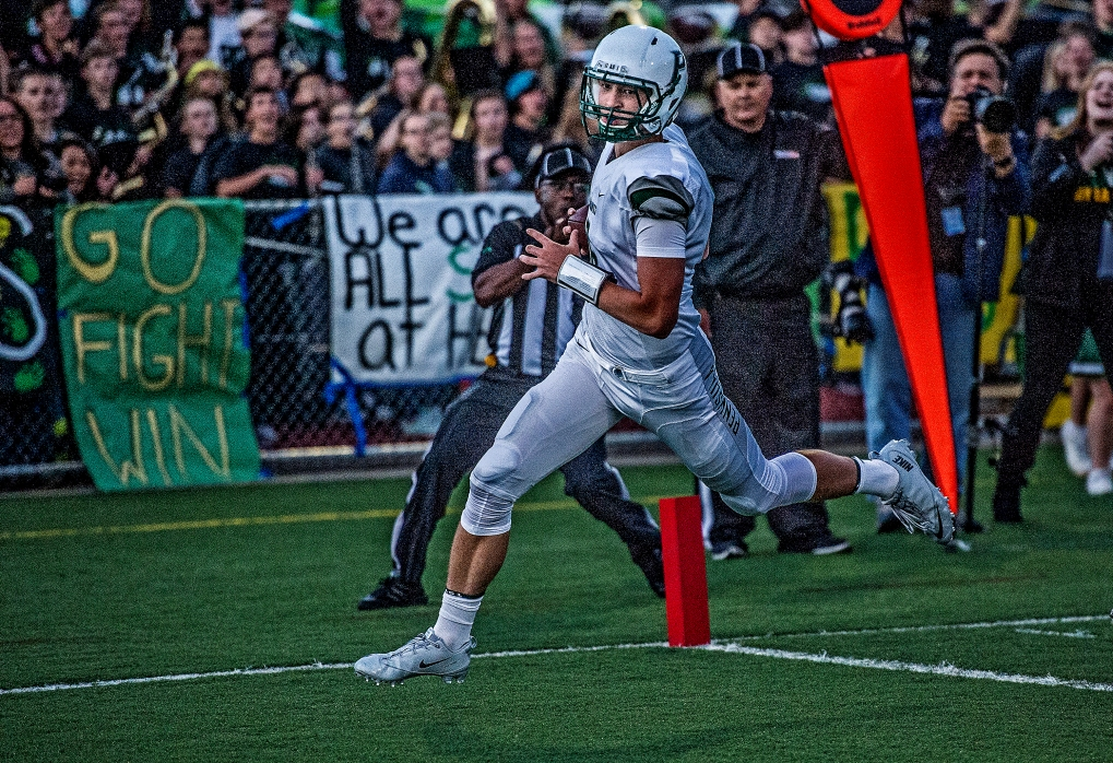 Peninsula's quarterback Ryder Johnson ran in a touchdown early in the first half, keeping the game level.
