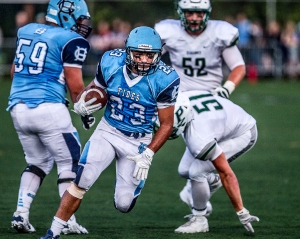 Gig Harbor's Adrian Valona  runs for a touchdown unmolestede in the first half.