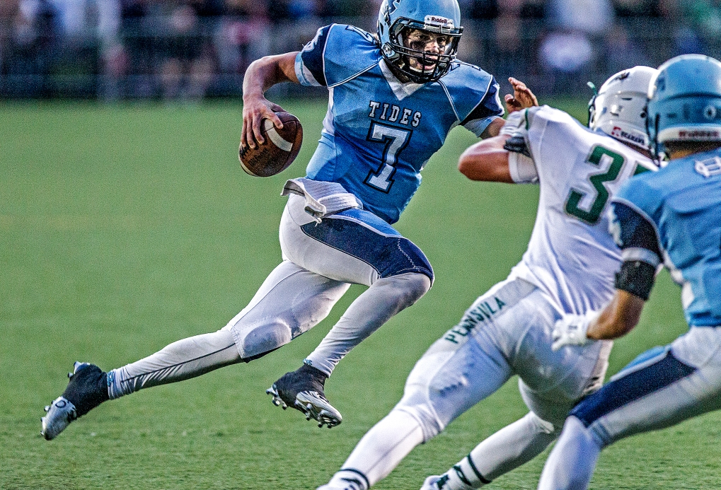Peninsula could not contain Gig Harbor's Davis Alexander as he led the Tides' attack from the air and on the ground.