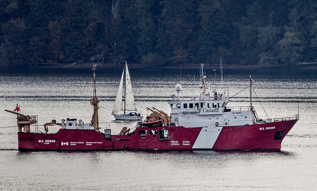 The Canada Coast Guard Ship W.E. Ricker rumbles down Drayton Passage Sunday morning, as a white-hulled sloop sails by.