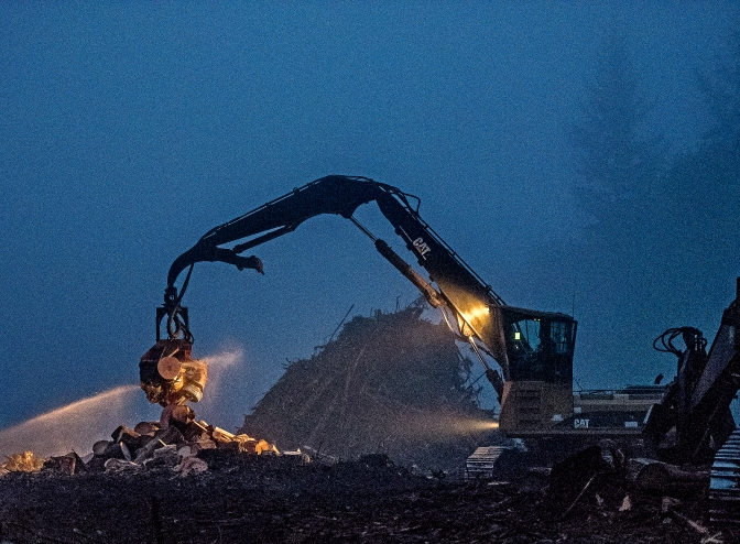 A logging operation in Longbranch, Washington, early Wednesday Oct. 21, 2015, underway in a thick fog long before sunrise.