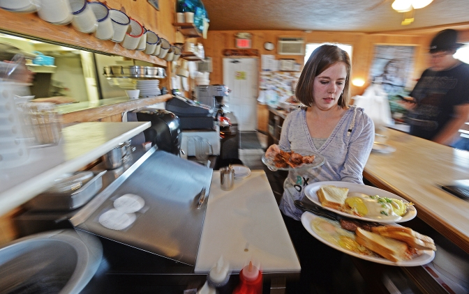 Lisa Rolfzen gets an order out at Lulu's Homeport bar and restaurant in Home Sunday March 29, 2015. Lulu's is a local favorite on the Key Peninsula's southern tip.