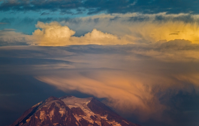 Evening clouds move in over Mount Rainier viewed from Longbranch, Washington, Monday Aug. 24, 2015.