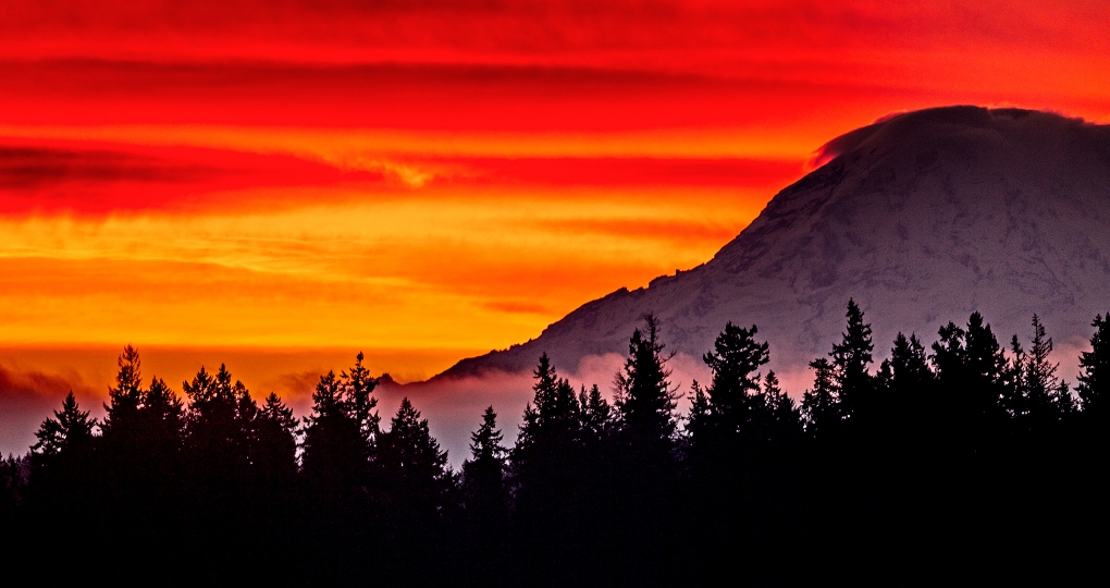 A crimson sky over Mount Rainier just before sunrise Wednesday Nov. 4, 2015.