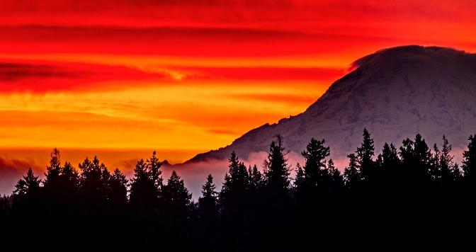 A crimson sky over Mount Rainier just before sunrise Wednesday Nov. 4, 2015.